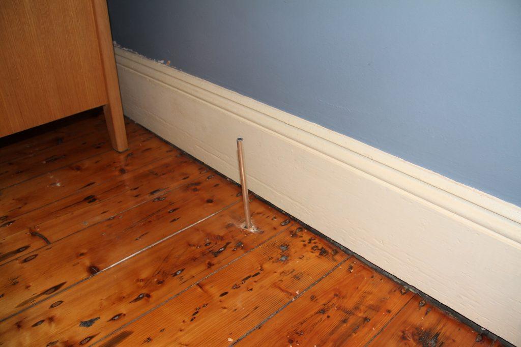 sinking floor keyhole pipe