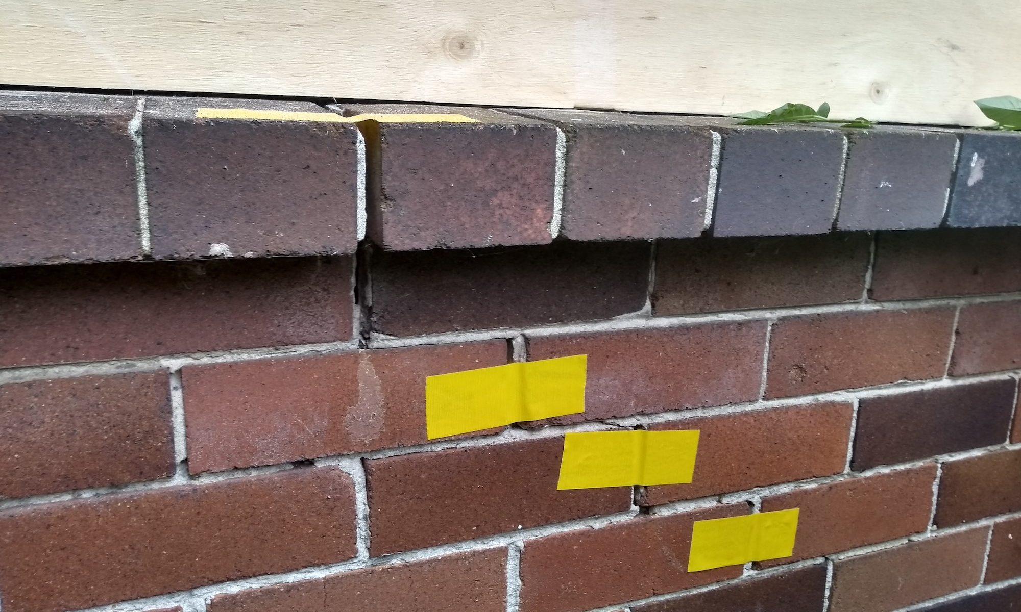 Brick cracks with tape