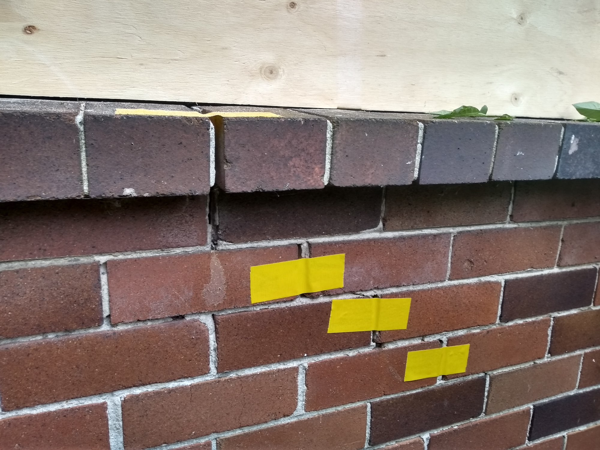 Brick cracks with tape