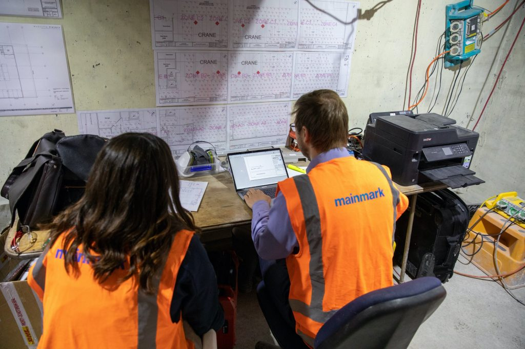 Mainmark technicians evaluating findings
