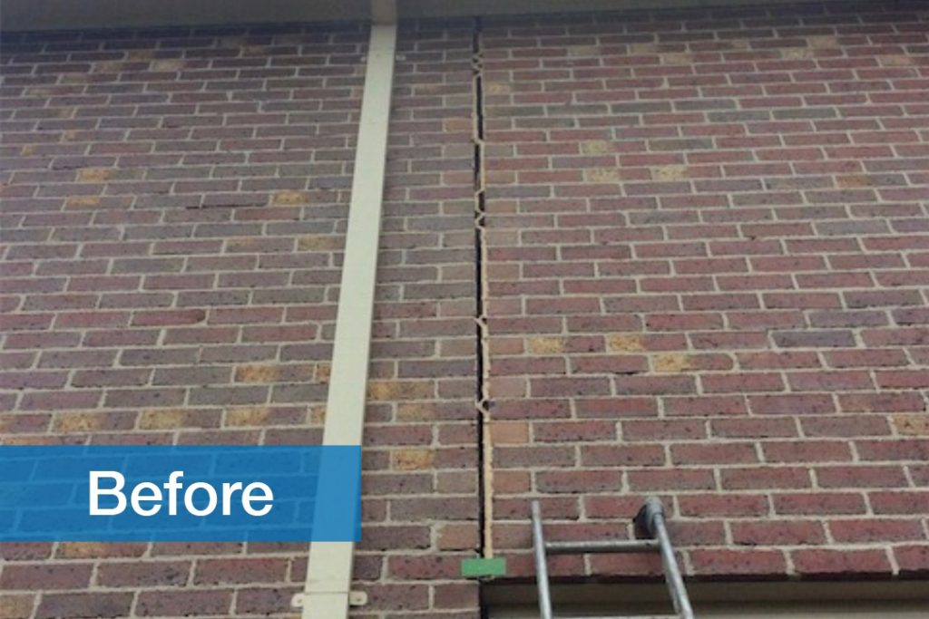 before image of residential brick wall with crack
