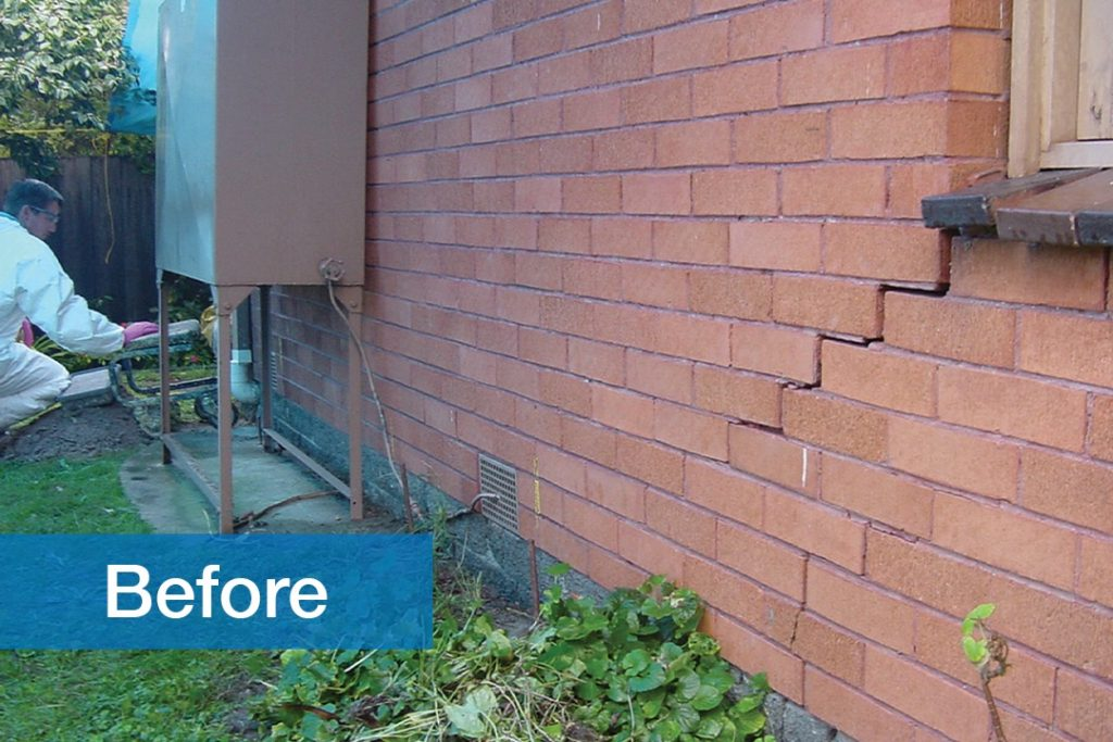 before image of residential brick wall with a crack